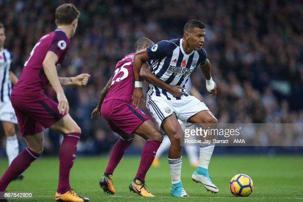Fernandinho of Manchester City and Jose Solomon Rondon of West Bromwich Albion during the Premier League match between West Bromwich Albion and...