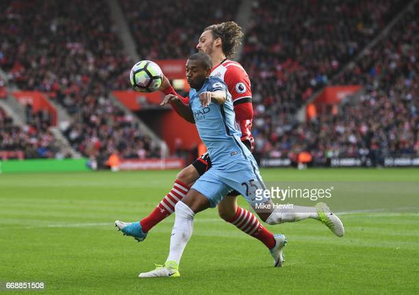Fernandinho of Manchester City and Manolo Gabbiadini of Southampton battle for possession during the Premier League match between Southampton and...