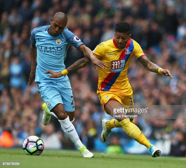 Fernandinho of Manchester City and Patrick van Aanholt of Crystal Palace battle for possession during the Premier League match between Manchester...