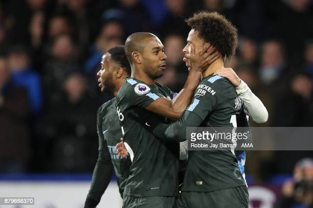 Fernandinho of Manchester City calms down Leroy Sane of Manchester City after he is slapped by Rajiv Van La Parra of Huddersfield Town during the...