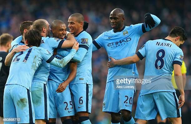 Fernandinho of Manchester City celebrartes with team mates after scoring the second goal during the Barclays Premier League match between Manchester...