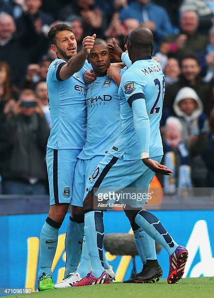 Fernandinho of Manchester City celebrates his winning goal with Martin Demichelis and Eliaquim Mangala of Manchester City during the Barclays Premier...