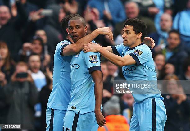Fernandinho of Manchester City celebrates his winning goal with Jesus Navas of Manchester City during the Barclays Premier League match between...