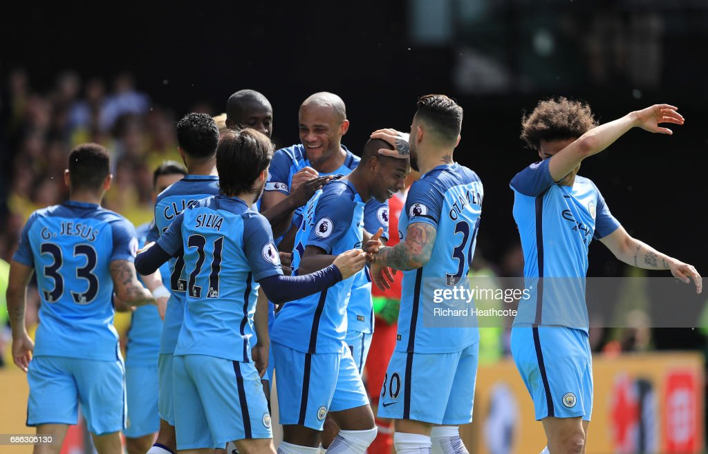 Fernandinho of Manchester City celebrates scoring his sides fourth goal with his Manchester City team mates during the Premier League match between Watford and Manchester City at Vicarage Road on May 21, 2017 in Watford, England.