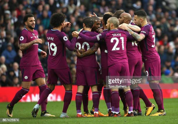 Fernandinho of Manchester City celebrates scoring his sides second goal with his Manchester City team mates during the Premier League match between...