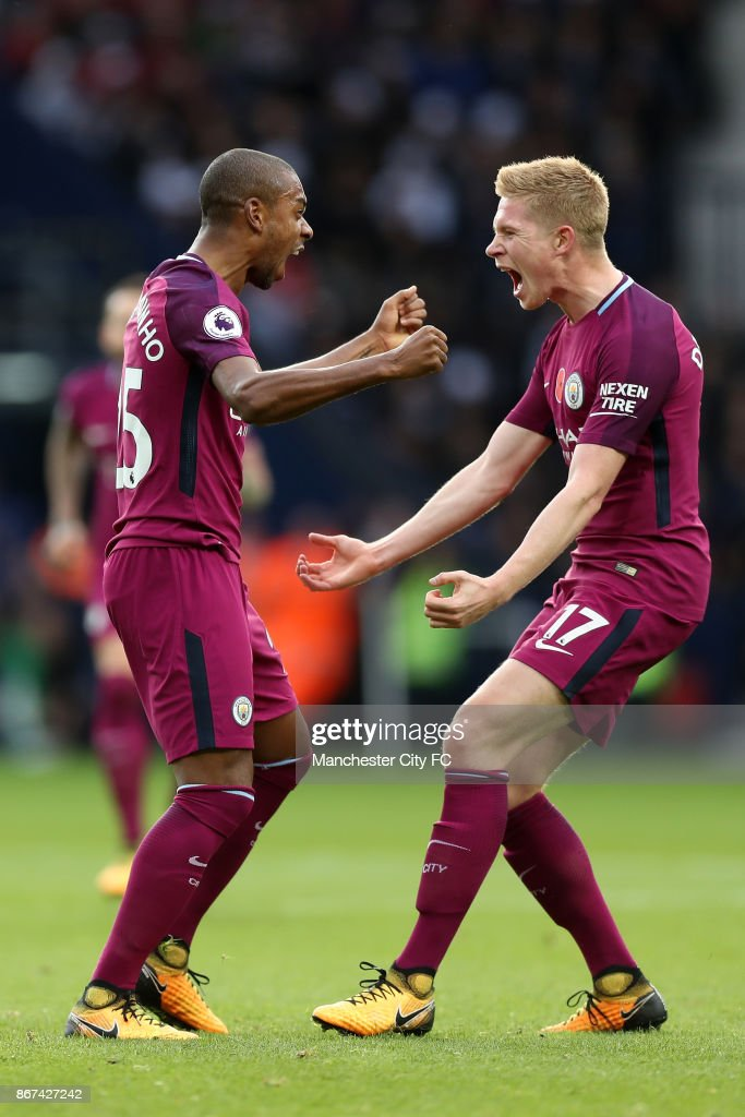 Fernandinho of Manchester City celebrates scoring his sides second goal with Kevin De Bruyne of Manchester City during the Premier League match between West Bromwich Albion and Manchester City at The Hawthorns on October 28, 2017 in West Bromwich, England.