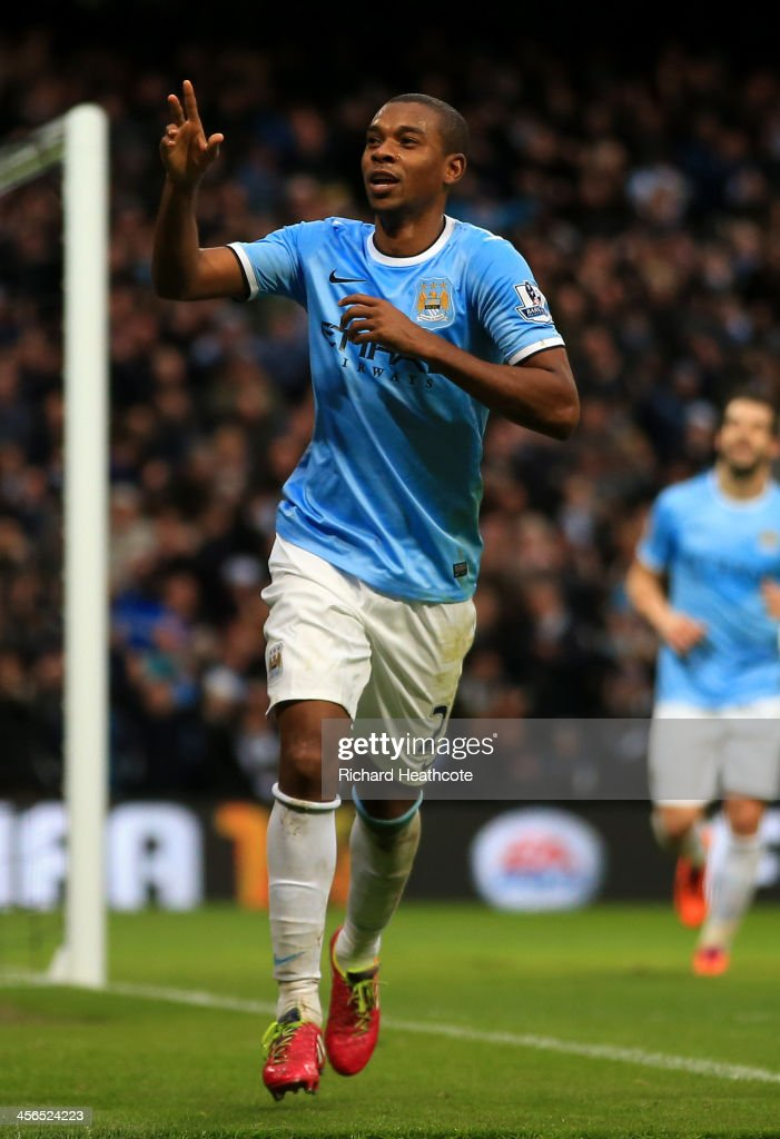 <a gi-track='captionPersonalityLinkClicked' href=/galleries/search?phrase=Fernandinho+-+Soccer+Player+-+Manchester+City&family=editorial&specificpeople=10093285 ng-click='$event.stopPropagation()'>Fernandinho</a> of Manchester City celebrates scoring their fifth goal during the Barclays Premier League match between Manchester City and Arsenal at Etihad Stadium on December 14, 2013 in Manchester, England.