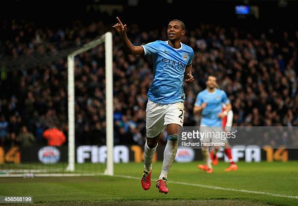 Fernandinho of Manchester City celebrates scoring their fifth goal past Wojciech Szczesny of Arsenal during the Barclays Premier League match between...