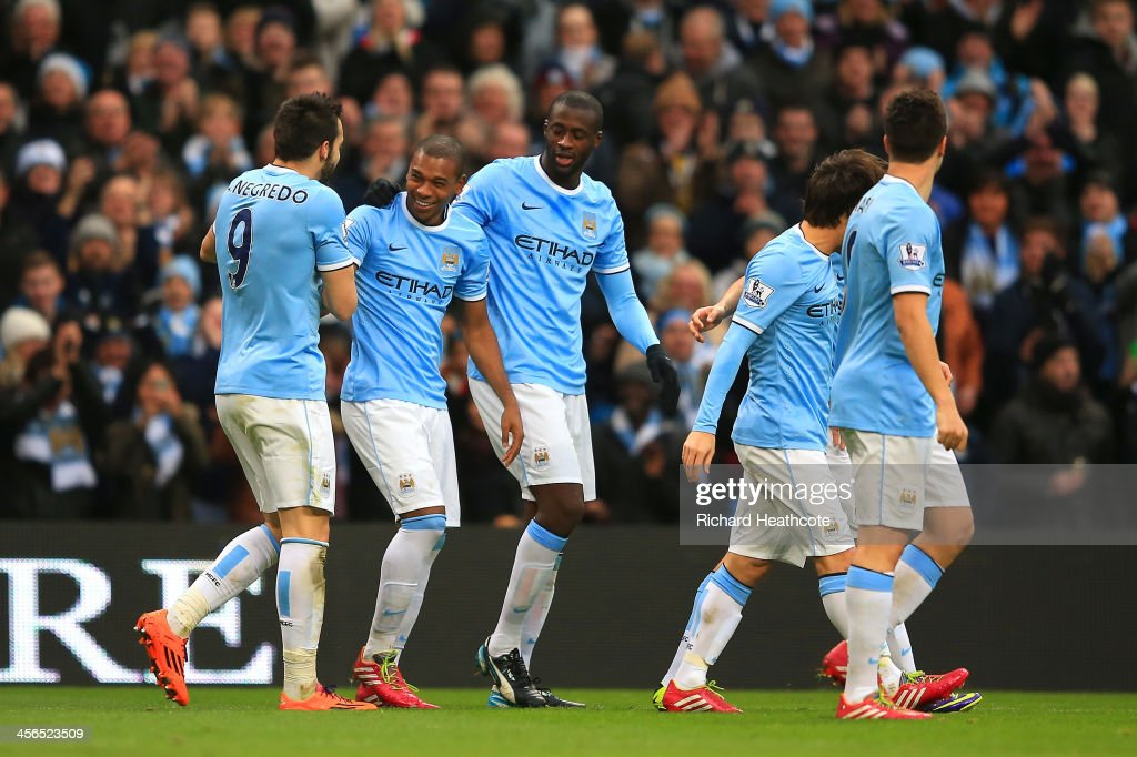 <a gi-track='captionPersonalityLinkClicked' href=/galleries/search?phrase=Fernandinho+-+Soccer+Player+-+Manchester+City&family=editorial&specificpeople=10093285 ng-click='$event.stopPropagation()'>Fernandinho</a> of Manchester City celebrates with team mates after scoring their third goal during the Barclays Premier League match between Manchester City and Arsenal at Etihad Stadium on December 14, 2013 in Manchester, England.