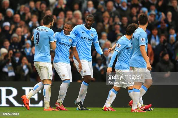 Fernandinho of Manchester City celebrates with team mates after scoring their third goal during the Barclays Premier League match between Manchester...