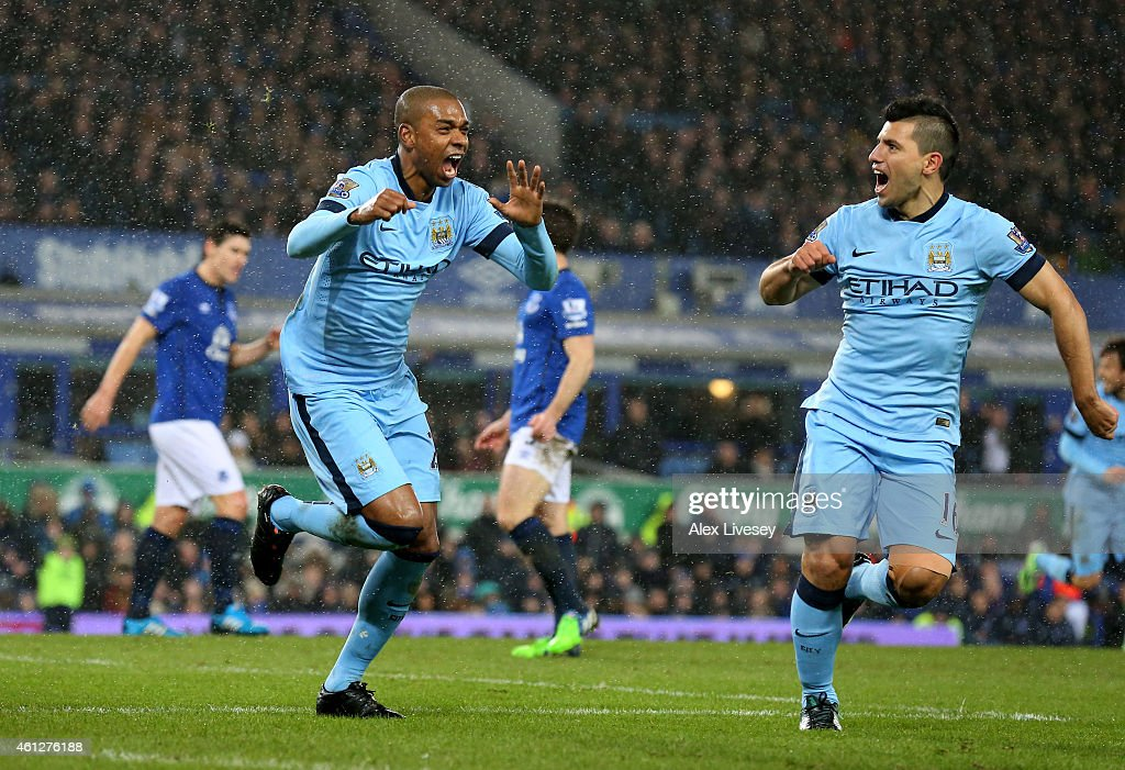 <a gi-track='captionPersonalityLinkClicked' href=/galleries/search?phrase=Fernandinho+-+Soccer+Player+-+Manchester+City&family=editorial&specificpeople=10093285 ng-click='$event.stopPropagation()'>Fernandinho</a> of Manchester City celebrates with teammate <a gi-track='captionPersonalityLinkClicked' href=/galleries/search?phrase=Sergio+Aguero&family=editorial&specificpeople=1100704 ng-click='$event.stopPropagation()'>Sergio Aguero</a> (R) after scoring the opening goal during the Barclays Premier League match between Everton and Manchester City at Goodison Park on January 10, 2015 in Liverpool, England.