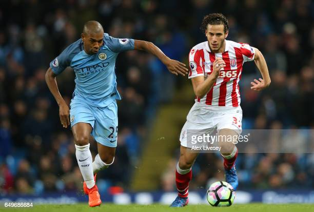 Fernandinho of Manchester City chases Ramadan Sobhi of Stoke City during the Premier League match between Manchester City and Stoke City at Etihad...