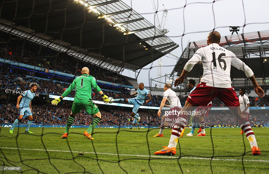 Fernandinho of Manchester City scores his team's third goal past Brad Guzan of Aston Villa during the Barclays Premier League match between Manchester City and Aston Villa at Etihad Stadium on April 25, 2015 in Manchester, England.