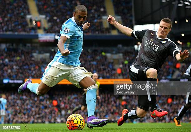 Fernandinho of Manchester City shoots at goal while Robert Huth of Leicester City tries to block during the Barclays Premier League match between...