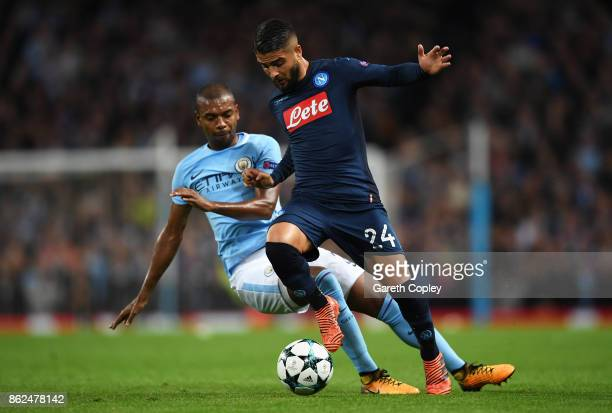 Fernandinho of Manchester City tackles Lorenzo Insigne of SSC Napoli during the UEFA Champions League group F match between Manchester City and SSC...