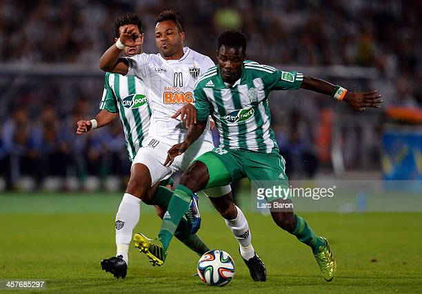 Fernandinho of Mineiro is challenged by Kouko Guehi of Casablanca during the FIFA Club World Cup Semi Final match between Raja Casablanca and...