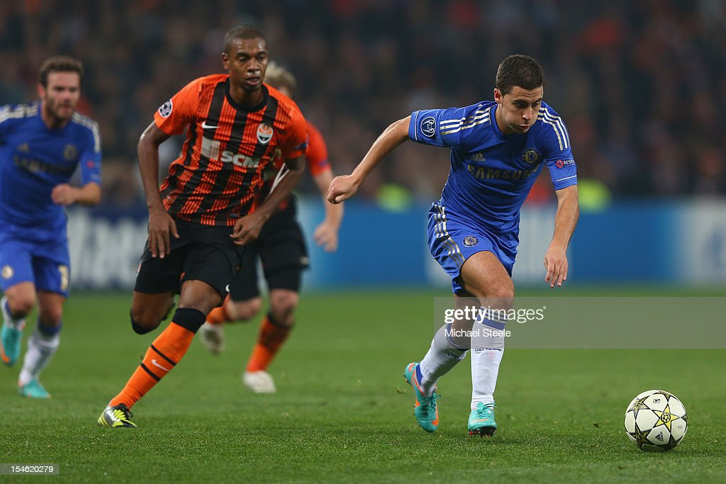 Fernandinho (L) of Shakhtar Donetsk tracks Eden Hazard (R) of Chelsea during the UEFA Champions League Group E match between Shakhtar Donetsk and Chelsea at the Donbass Arena on October 23, 2012 in Donetsk, Ukraine.