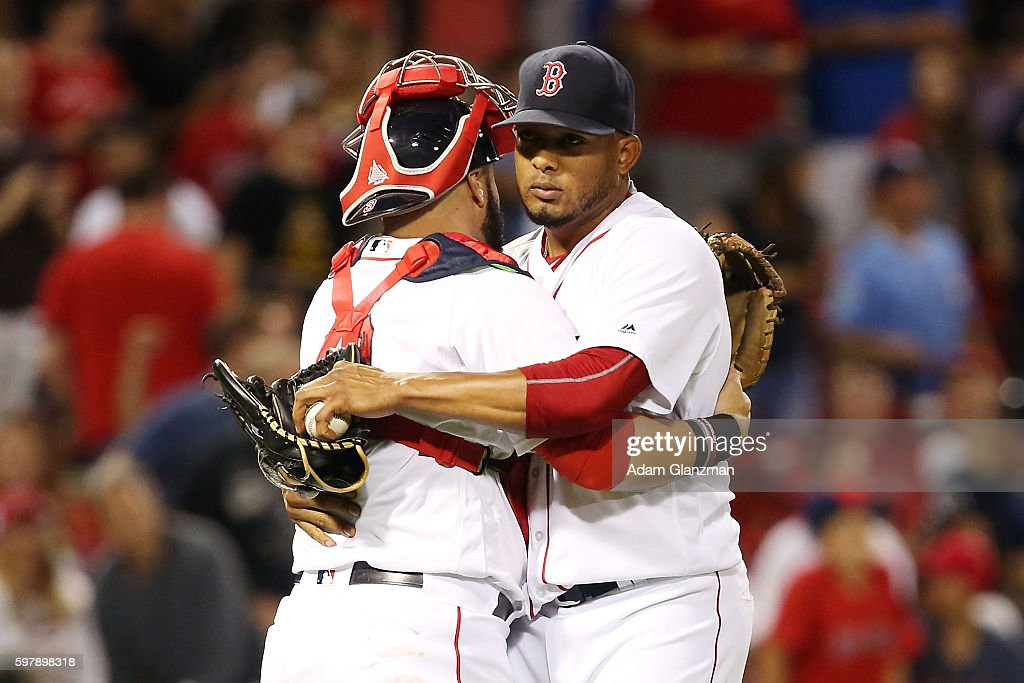 Fernando Abad embraces Sandy Leon of the Boston Red Sox after their victory over the Tampa Bay Rays at Fenway Park on August 29 2016 in Boston...