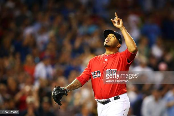 Fernando Abad of the Boston Red Sox rectas after making the third out in the eighth inning of a game against the Chicago Cubs at Fenway Park on April...