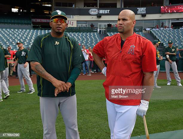 Fernando Abad of the Oakland Athletics and Albert Pujols of the Los Angeles Angels of Anaheim talk before the game at Angel Stadium of Anaheim on...