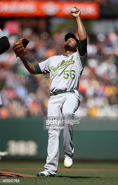 Fernando Abad of the Oakland Athletics celebrates and kisses the baseball after the game against the San Francisco Giants at ATT Park on Thursday...