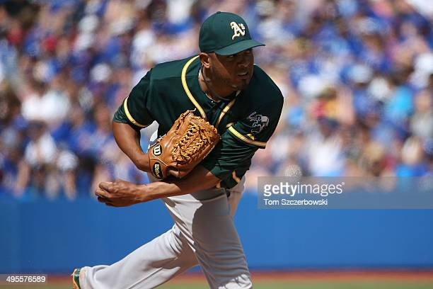 Fernando Abad of the Oakland Athletics delivers a pitch in the eighth inning during MLB game action against the Toronto Blue Jays on May 25 2014 at...