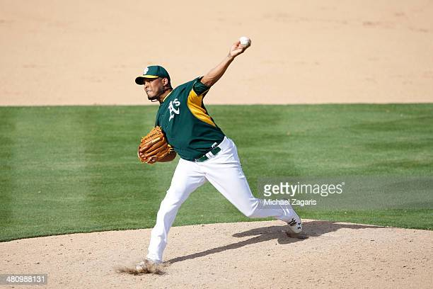 Fernando Abad of the Oakland Athletics pitches during a spring training game against the Los Angeles Dodgers at Phoenix Municipal Stadium on March 3...