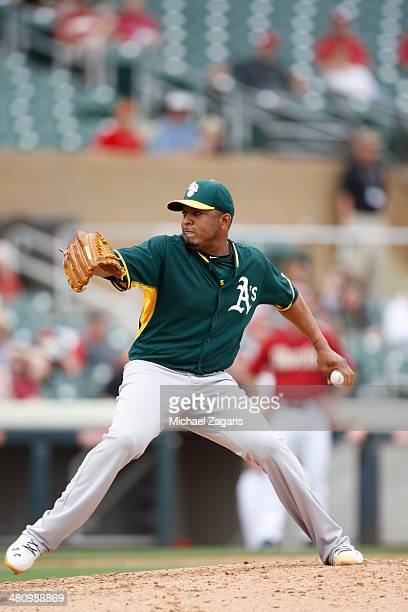 Fernando Abad of the Oakland Athletics pitches during a spring training game against the Arizona Diamondbacks at Salt River Fields at Talking Stick...