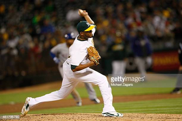 Fernando Abad of the Oakland Athletics pitches during the game against the Texas Rangers at Oco Coliseum on June 17 2014 in Oakland California The...