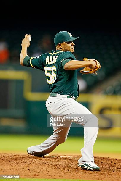 Fernando Abad of the Oakland Athletics pitches during the game against the Houston Astros at Minute Maid Park on August 27 2014 in Houston Texas The...