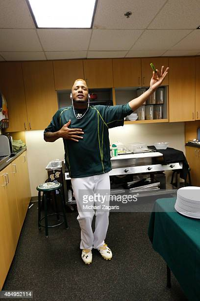 Fernando Abad of the Oakland Athletics sings and dances in the clubhouse prior to the game against the Houston Astros at Oco Coliseum on August 7...