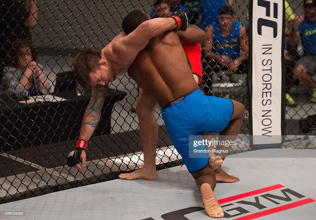 Fernando Acougueiro pushes Nazareno Malagarie up against the cage during the semifinals for filming of The Ultimate Fighter Brazil Team Nogueira vs...