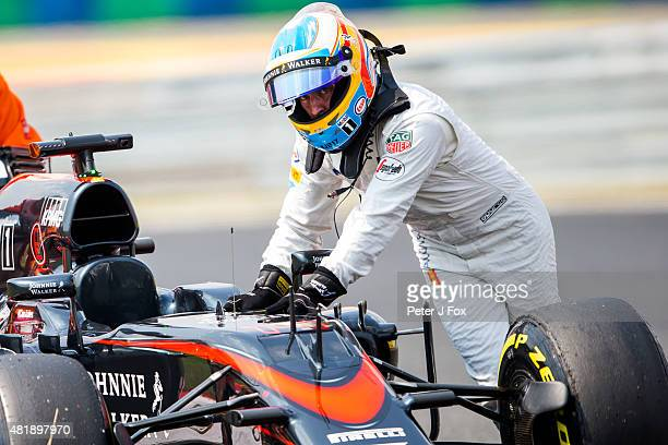 Fernando Alonso and McLaren and Spain breaks down during qualifying for the Formula One Grand Prix of Hungary at Hungaroring on July 25 2015 in...