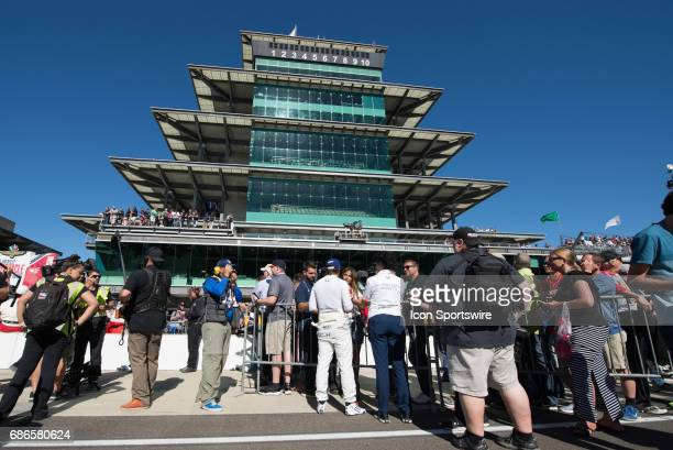 Fernando Alonso being interviewed following is qualification run on the second day of qualifications for the 101st Indianapolis on May 21 at the...