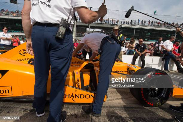 Fernando Alonso getting into his car on the first day of qualifications for the 101st Indianapolis on May 20 at the Indianapolis Motor Speedway in...