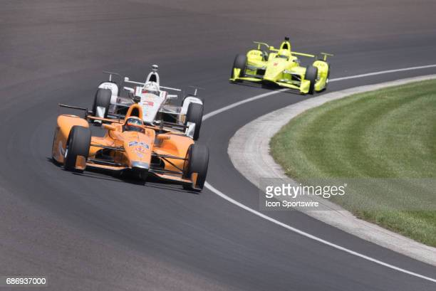 Fernando Alonso leading a pack of cars on day six of practice for the 101st Indianapolis on May 22 at the Indianapolis Motor Speedway in Indianapolis...
