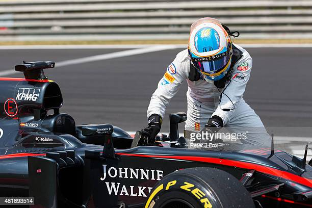 Fernando Alonso of McLaren and Spain breaks down during qualifying for the Formula One Grand Prix of Hungary at Hungaroring on July 25 2015 in...