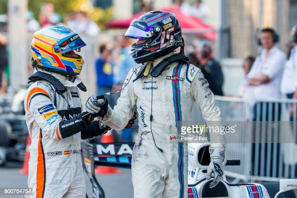 Fernando Alonso of McLaren and Spain congratulates Lance Stroll of Williams and Canada during the Azerbaijan Formula One Grand Prix at Baku City...