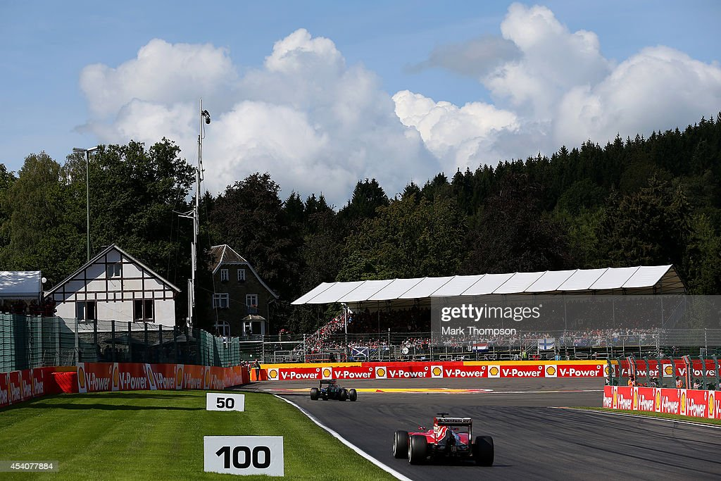 Fernando Alonso of Spain and Ferrari and Nico Hulkenberg of Germany and Force India drive during the Belgian Grand Prix at Circuit de Spa-Francorchamps on August 24, 2014 in Spa, Belgium.
