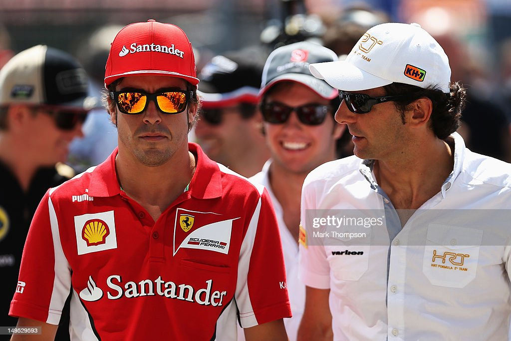 Fernando Alonso of Spain and Ferrari and Pedro de la Rosa of Spain and Hispania Racing Team attend the drivers parade before the Hungarian Formula One Grand Prix at the Hungaroring on July 29, 2012 in Budapest, Hungary.