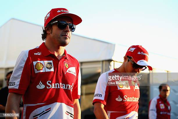 Fernando Alonso of Spain and Ferrari and team mate Felipe Massa of Brazil walk in the paddock during previews for the Japanese Formula One Grand Prix...