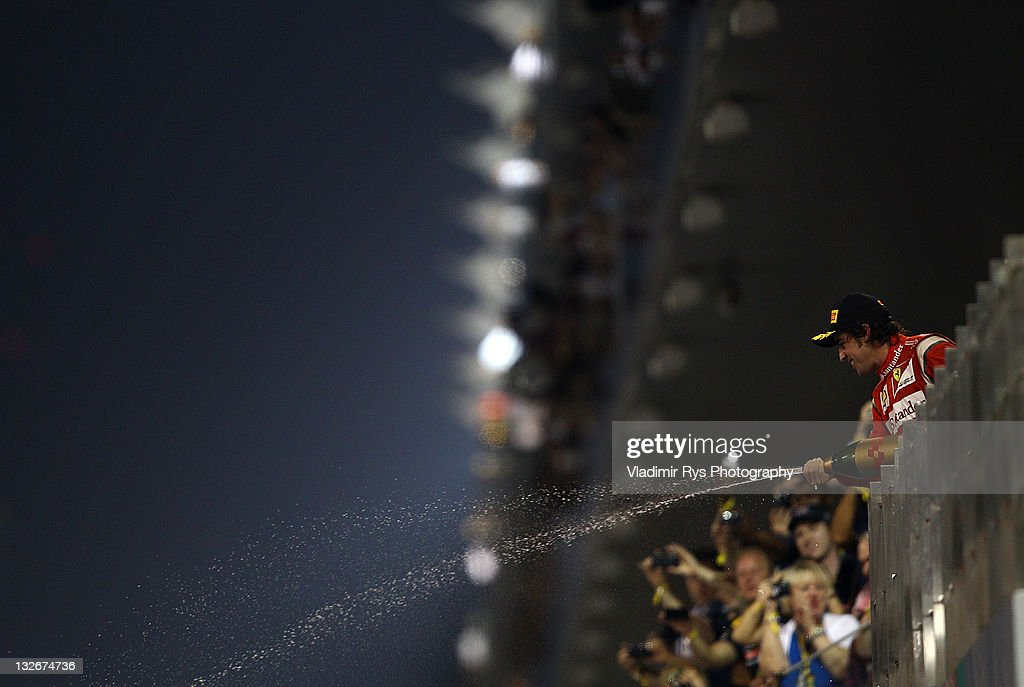 Fernando Alonso of Spain and Ferrari celebrates after finishing second at the Formula One Grand Prix of Abu Dhabi at Yas Marina Circuit on November 13, 2011 in Abu Dhabi, United Arab Emirates.