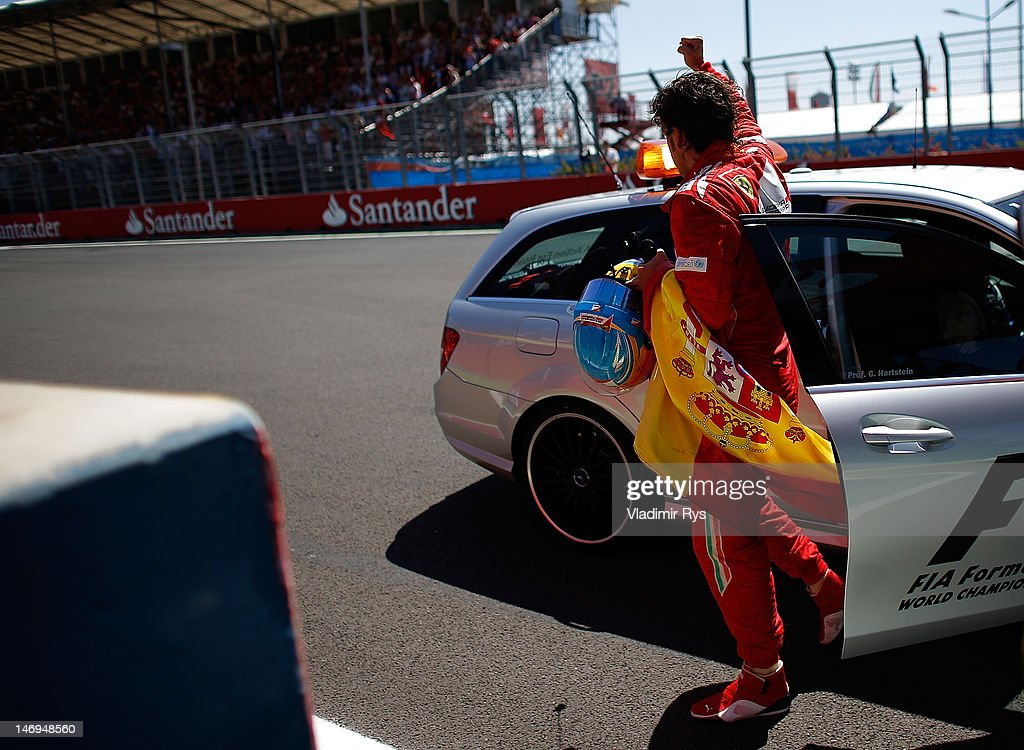 Fernando Alonso of Spain and Ferrari celebrates after winning the European Grand Prix at the Valencia Street Circuit on June 24, 2012 in Valencia, Spain.