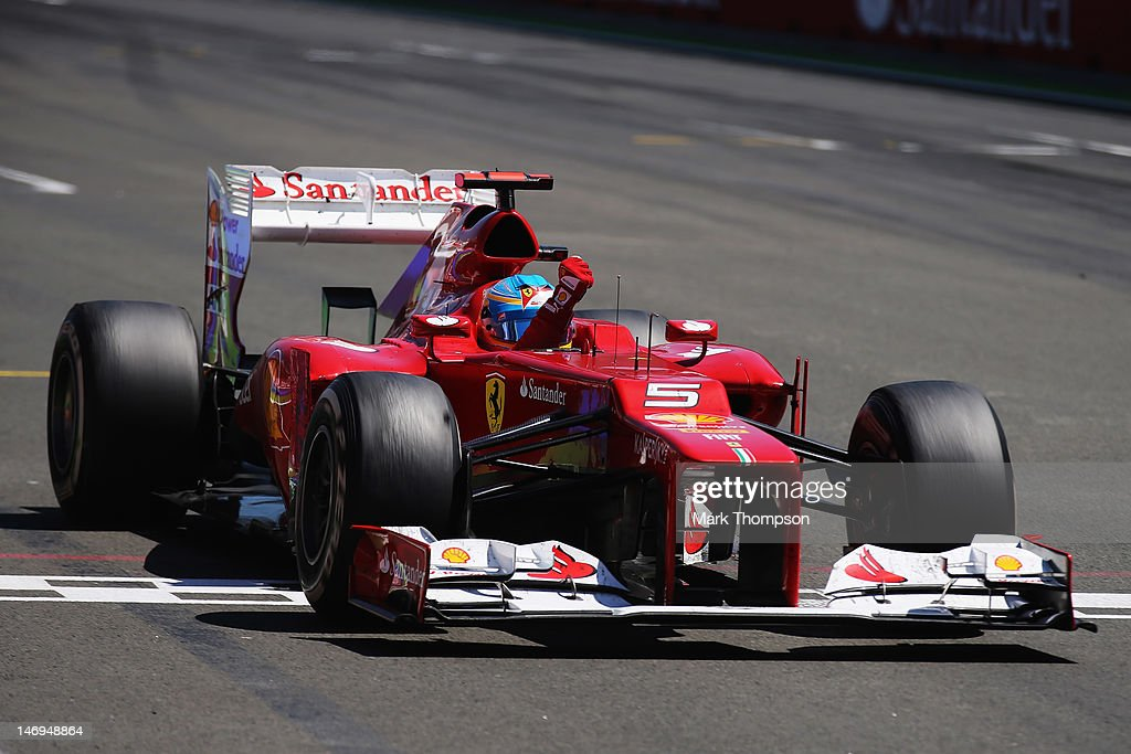 Fernando Alonso of Spain and Ferrari celebrates as he crosses the finish line to win the European Grand Prix at the Valencia Street Circuit on June 24, 2012 in Valencia, Spain.