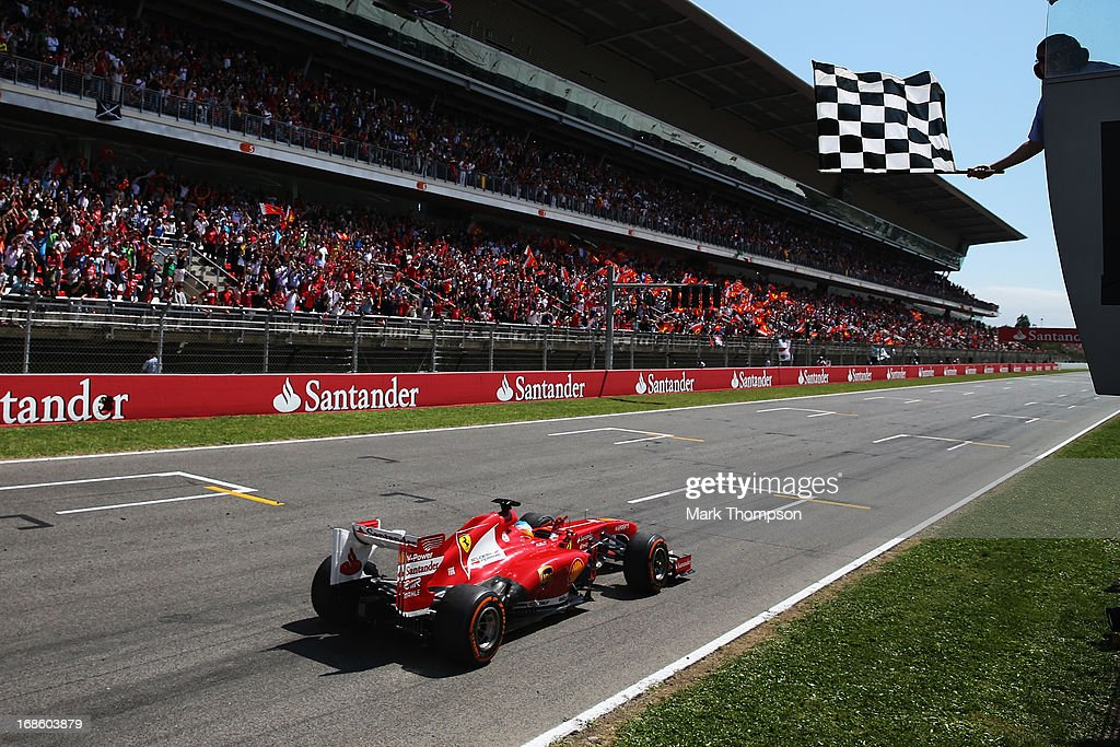 Fernando Alonso of Spain and Ferrari celebrates as he crosses the finishing line to win the Spanish Formula One Grand Prix at the Circuit de Catalunya on May 12, 2013 in Montmelo, Spain.