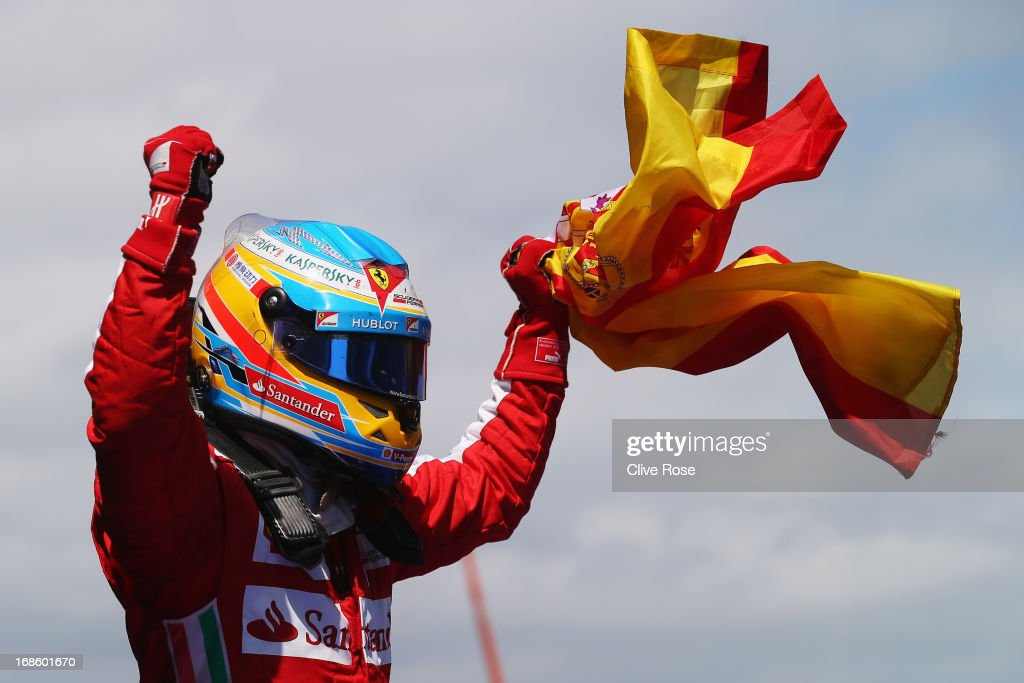 Fernando Alonso of Spain and Ferrari celebrates in parc ferme after winning the Spanish Formula One Grand Prix at the Circuit de Catalunya on May 12, 2013 in Montmelo, Spain.