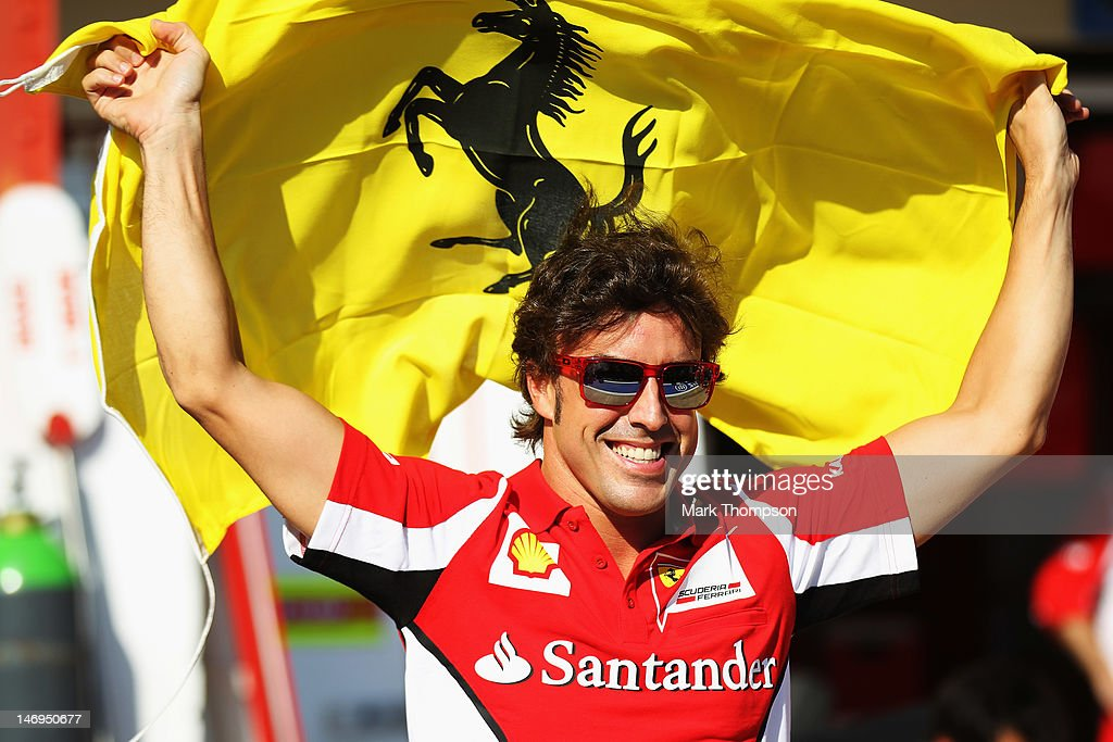Fernando Alonso of Spain and Ferrari celebrates with team mates in the paddock following his victory in the European Grand Prix at the Valencia Street Circuit on June 24, 2012 in Valencia, Spain.