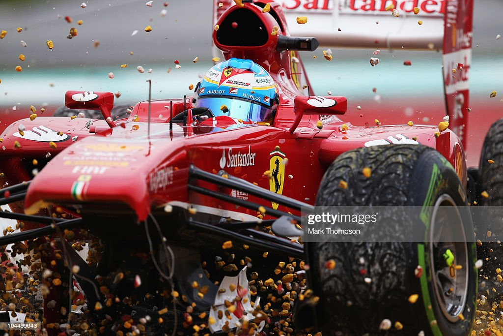 Fernando Alonso of Spain and Ferrari crashes into the gravel trap at turn one after sustaining front wing damage during the Malaysian Formula One Grand Prix at the Sepang Circuit on March 24, 2013 in Kuala Lumpur, Malaysia.