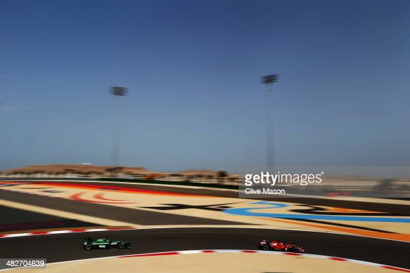 Fernando Alonso of Spain and Ferrari drives ahead of Robin Frijns of The Netherlands and Caterham during practice for the Bahrain Formula One Grand...