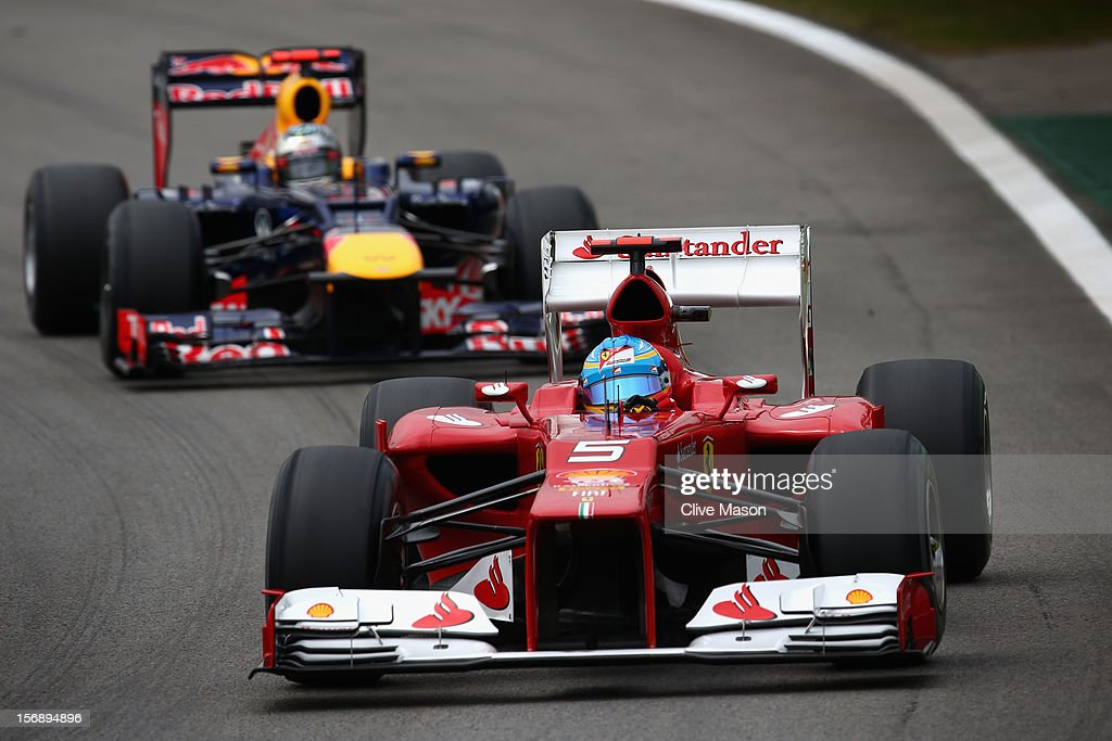 Fernando Alonso of Spain and Ferrari drives ahead of Sebastian Vettel of Germany and Red Bull Racing during the final practice session prior to qualifying for the Brazilian Formula One Grand Prix at the Autodromo Jose Carlos Pace on November 24, 2012 in Sao Paulo, Brazil.